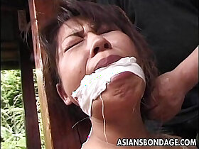 asian porn - Tied up mature cougar to a house beam